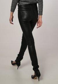 Oakwood - P ANDORA - Leather trousers - black - 3