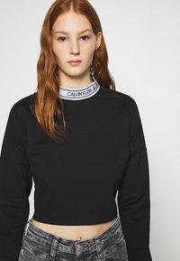 Calvin Klein Jeans - LOGO ELASTIC MILANO - Long sleeved top - black - 4