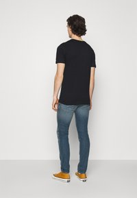 Diesel - THOMMER-X - Slim fit jeans - medium blue - 2