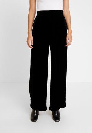 Pantalones - true black