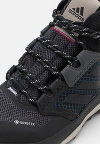 adidas Performance - TERREX TRAILMAKER MID GORE-TEX - Hiking shoes - grey six/core black/purple tint - 5
