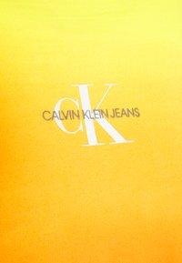 Calvin Klein Jeans - LOOSE BOAT NECK  - Sweatshirt - yellow - 2