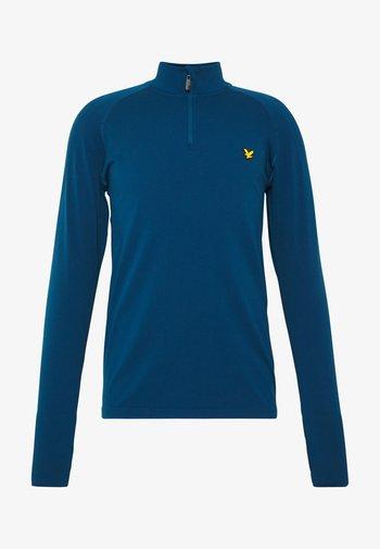 PERFORMANCE SEAMLESS MIDLAYER - Sports shirt - deep fjord marl