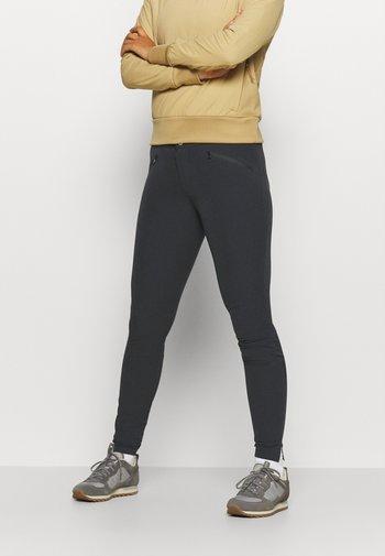 FALKETIND FLEX1 SLIM PANTS - Kalhoty - black