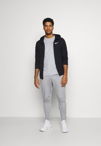 Nike Performance - PANT CAPRA - Pantaloni sportivi - particle grey/black - 1