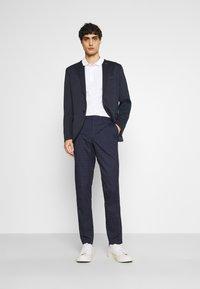 Selected Homme - SLHSLIM KYLELOGAN  - Trousers - navy blue/light blue - 1
