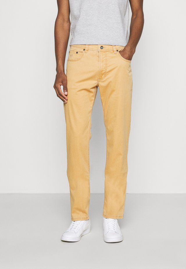 BROKEN TROUSER - Pantaloni - yellow