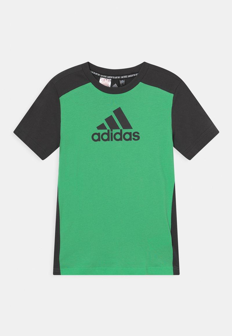 adidas Performance - UNISEX - T-shirts print - semi screaming green/carbon