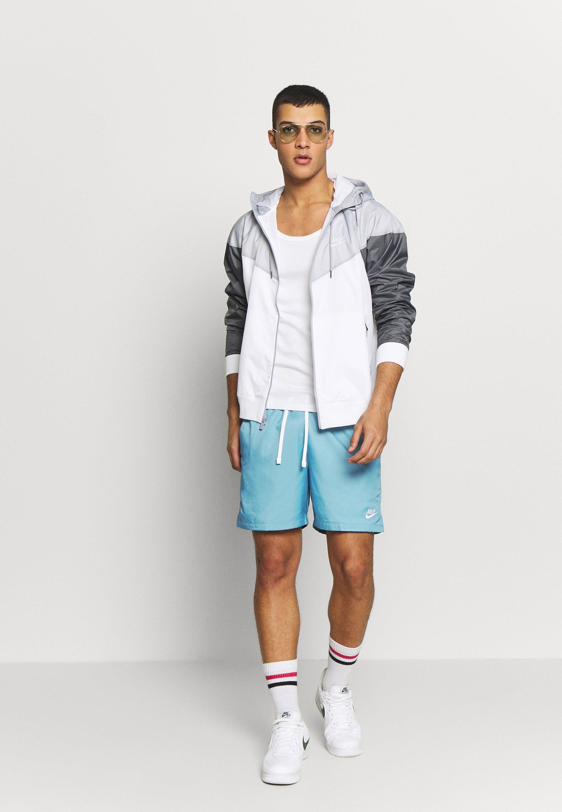 Nike Sportswear FLOW  - Shorts - cerulean/thunderstorm/white