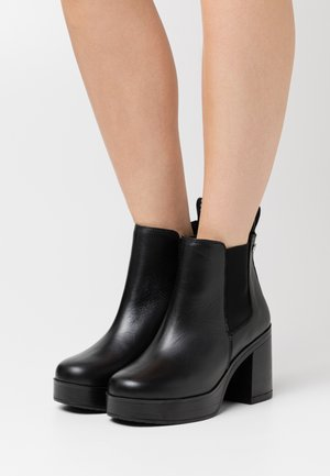 RONAN - Platform ankle boots - black