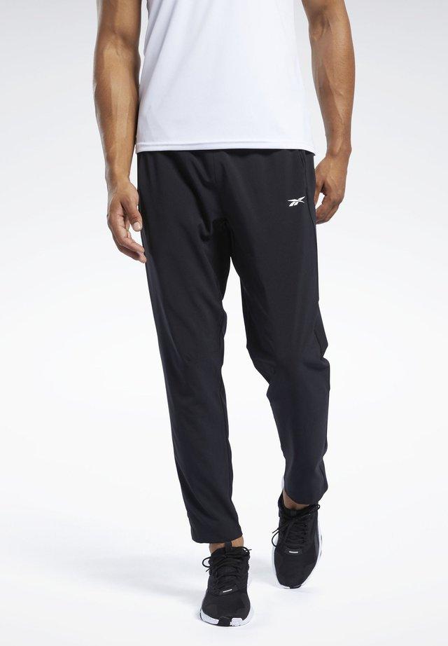 WORKOUT READY TRACKSTER PANTS - Teplákové kalhoty - black