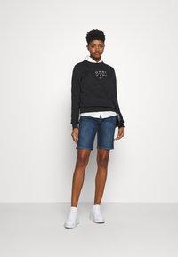 Tommy Jeans - MID RISE BERMUDA - Denim shorts - dark blue - 1