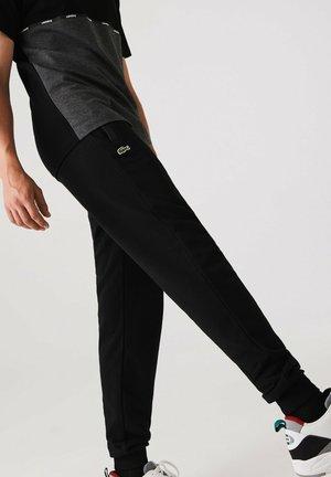 XH1501 - Tracksuit bottoms - schwarz / schwarz