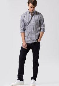 BRAX - STYLE COOPER  - Straight leg jeans - dark blue - 1