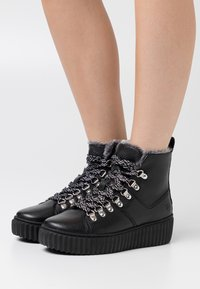 Tamaris - Winter boots - black - 0