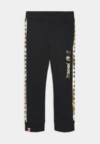 LEGO Wear - NINJAGO JUBILÄUM - Tracksuit bottoms - black - 0