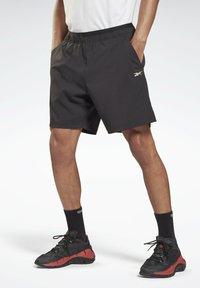 Reebok - LES MILLS ATHLETE - Pantalón corto de deporte - black - 0