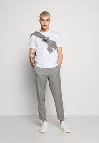 Filippa K - TERRY CROPPED PANTS - Trousers - mid grey melange - 1