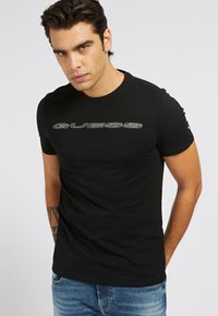 Guess - A$AP ROCKY - Print T-shirt - schwarz - 0
