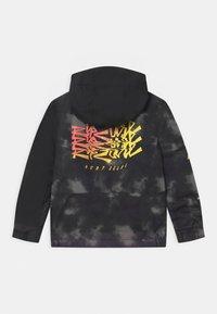 Rip Curl - OLLY UNISEX - Snowboard jacket - black - 1