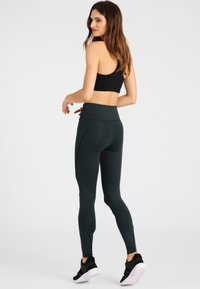 Daquïni - Leggings - Trousers - green