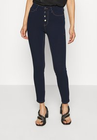 Guess - EXPOSED BUTTON - Jeans Skinny Fit - dark-blue denim - 0
