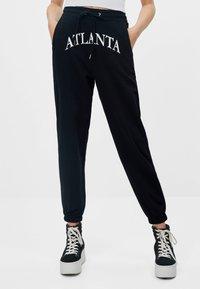 Bershka - Teplákové kalhoty - black - 0