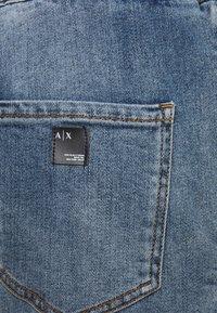 Armani Exchange - PANTALONI - Straight leg jeans - indigo denim - 2