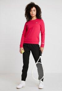 Lacoste Sport - WOMEN TENNIS TROUSERS - Träningsbyxor - black - 1
