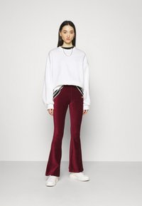 Ellesse - FLORIE - Trousers - burgundy - 1