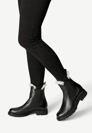 Kotníkové boty - black/fur