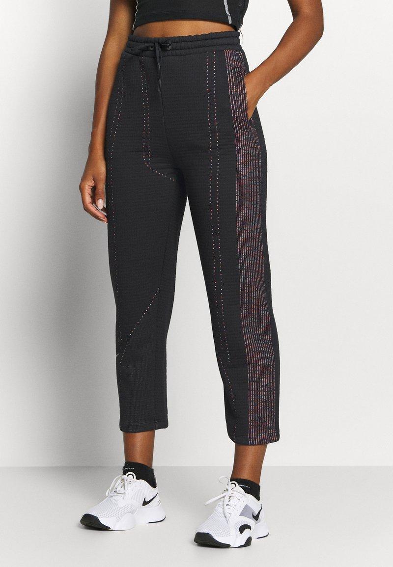 Nike Performance - PANT - Tracksuit bottoms - black