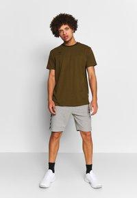 Hummel - HMLMOVE  - Sports shorts - grey melange - 1