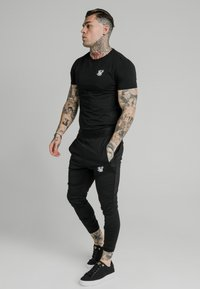 SIKSILK - AGILITY TRACK PANTS - Tracksuit bottoms - black - 1