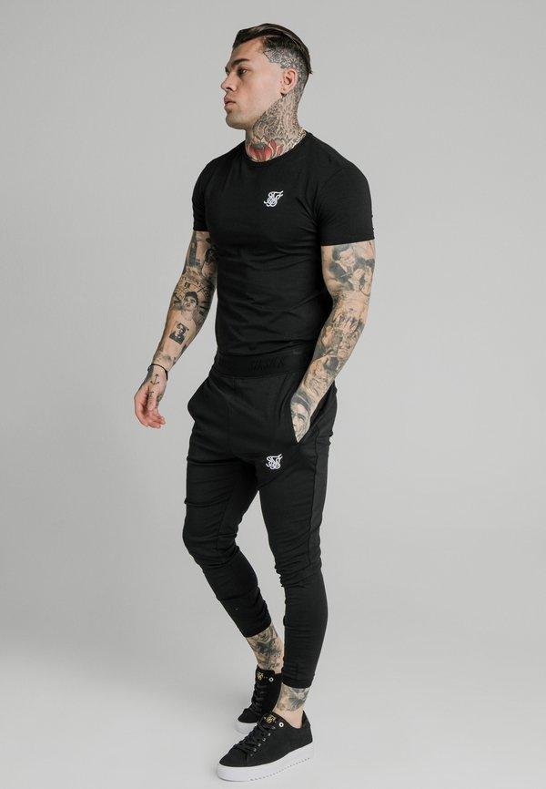 SIKSILK AGILITY TRACK PANTS - Spodnie treningowe - black/czarny Odzież Męska SQJU
