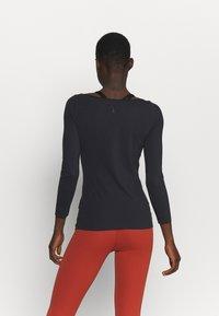 Nike Performance - THE YOGA LUXE - T-shirt sportiva - black/dark smoke grey - 2
