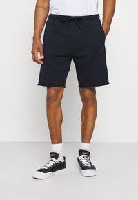 Scotch & Soda - SEASONAL FIT  CLASSIC FELPA  - Pantalon de survêtement - night - 0