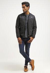Pier One - Slim fit jeans - dark blue denim - 1