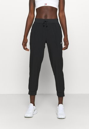 ACCELERATE PANT - Tracksuit bottoms - black