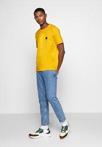 Bricktown - BOMB SMALL - Print T-shirt - yellow - 1