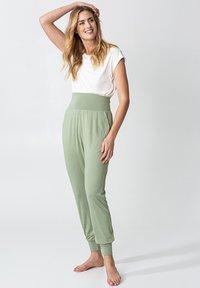 Indiska - YOGA - Tracksuit bottoms - green - 1