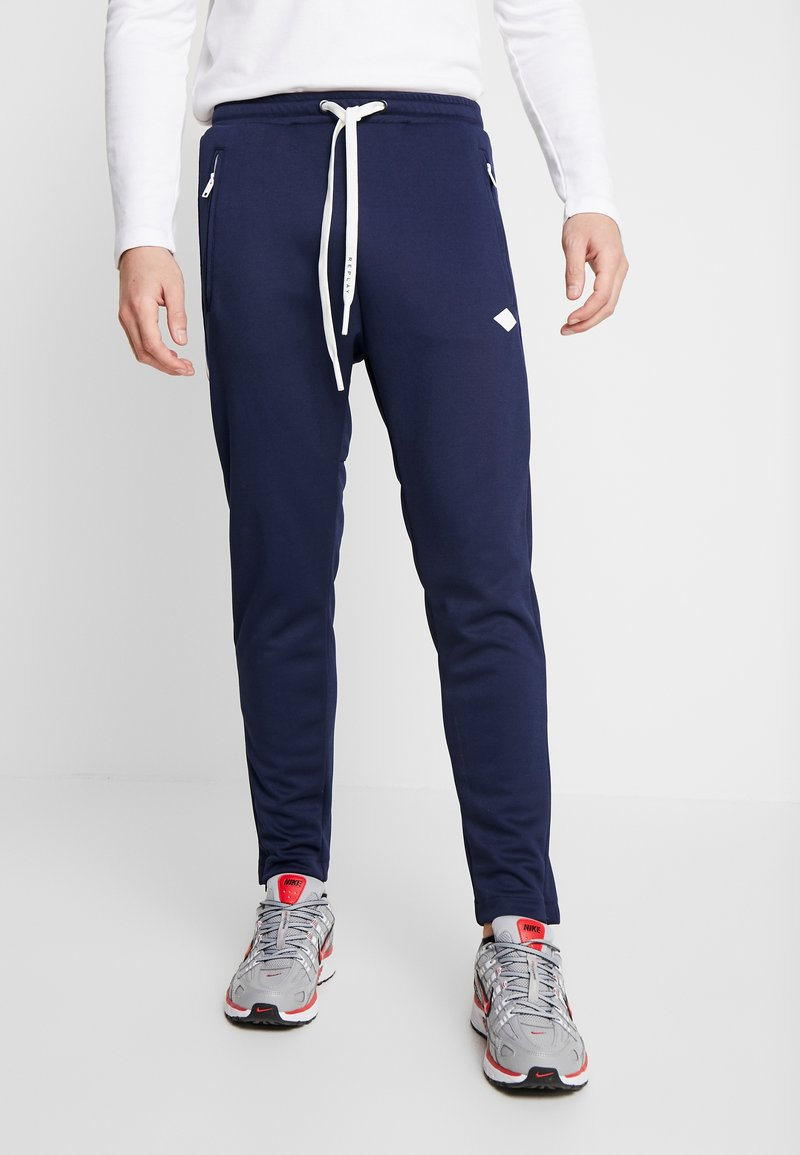 Replay - Tracksuit bottoms - space blue