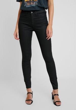 SLFGAIA COATED - Leggings - black