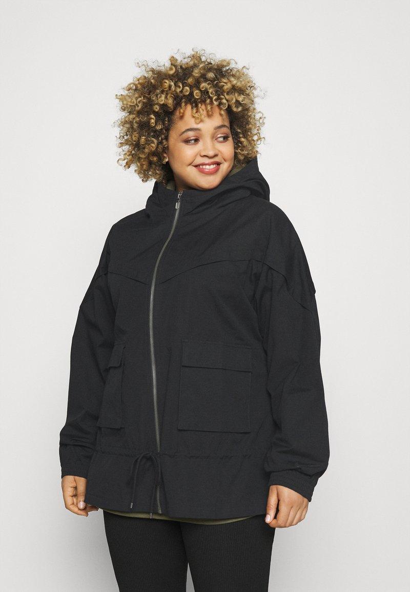 Nike Sportswear - Summer jacket - black/dark smoke grey