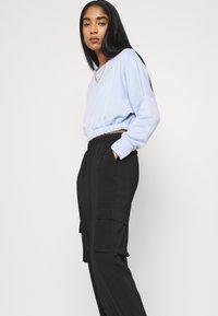 Vero Moda - VMCOCO PANT - Cargo trousers - black - 4