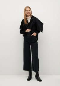 Mango - CAROLINE - Flared Jeans - black denim - 1