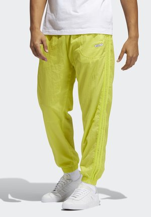 TRACKSUIT BOTTOMS - Tracksuit bottoms - yellow