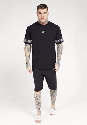 ESSENTIAL RUNNER OVERSIZED TEE - T-shirt con stampa - black