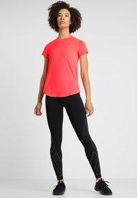 Puma - IGNITE TEE - T-shirt con stampa - pink alert - 1