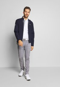 Lacoste Sport - HIGH PERFORMANCE JACKET - Waterproof jacket - navy blue/white - 1